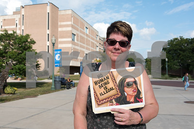 09/14/17  Wesley Bunnell   Staff  A rally was held at CCSU on Thursday afternoon in support of DACA. the Deferred Action for Childhood Arrivals policy was established by the Obama administration in June 2012 and recently rescinded by the Trump administration.  Laurie McFaddon of Middletown hods a sign reading no human being is illegal.