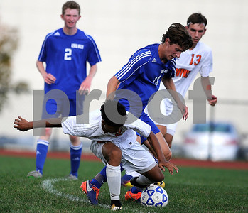 9/14/2017 Mike Orazzi | Staff Terryville's Devonne Dao (2) and Lewis Mills' John Mudgett (14) during boys soccer in Plymouth Thursday.