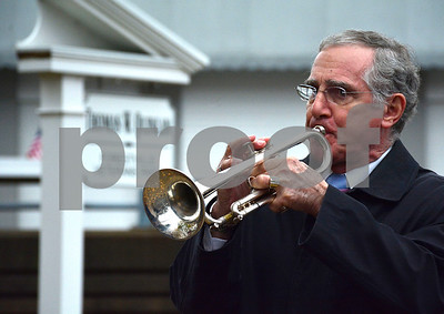 11/11/2015 Mike Orazzi | Staff Frank Nicastro plays Taps during Forestville's Salute to Veterans in Quinlan Veterans Park in Forestville on Wednesday.