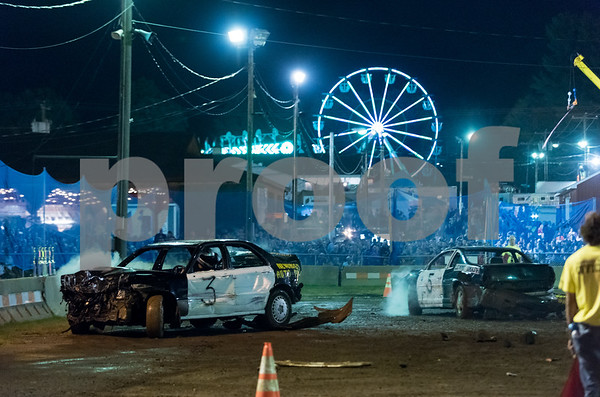 09/14/17 Wesley Bunnell | Staff A demolition derby was held on Thursday evening at the Berlin Fair as exhibitors continued to work into the evening in preparation for the weekend.