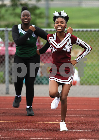 9/16/2017 Mike Orazzi | Staff Members of the Bulkeley/HMTCA/Weaver Cheerleading Squad during Saturday's football game with Plainville in Hartford.