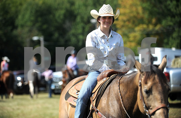 9/16/2017 Mike Orazzi | Staff Nicole Davidson waits for barrel racing to start with Ruler during the Berlin Lions Club Fair Saturday.