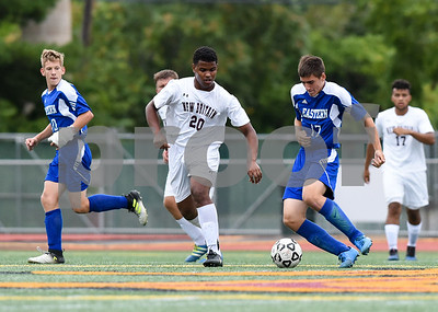 09/19/17 Wesley Bunnell | Staff  Bristol Eastern boys soccer defeated New Britain 7-0 on Tuesday afternoon at Veteran's Stadium in New Britain. New Britain's Carlos Mendez (20) and Bristol Eastern's Ben Chiasson #17.
