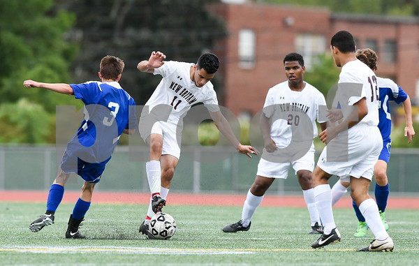 09/19/17 Wesley Bunnell | Staff Bristol Eastern boys soccer defeated New Britain 7-0 on Tuesday afternoon at Veteran's Stadium in New Britain. Bristol Easterns Patrick Brady #3 fits with New Britain's Joao Perdo Coelho (11) for the ball along with Carlos Mendez (20) and Kevin Carrasavillo (12).