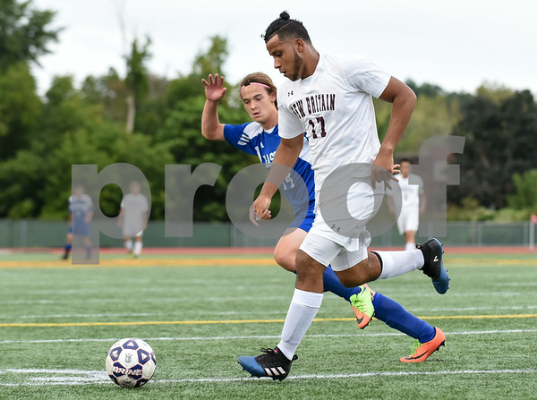 09/19/17 Wesley Bunnell | Staff Bristol Eastern boys soccer defeated New Britain 7-0 on Tuesday afternoon at Veteran's Stadium in New Britain. New Briatin's Nolber Gonzalez (17).