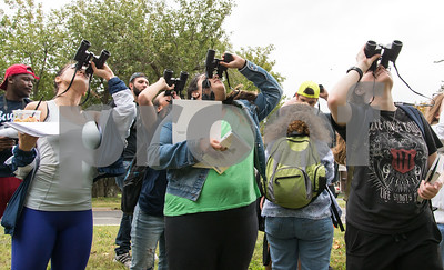 09/19/17 Wesley Bunnell | Staff  CCSU Professor Sylvia Halkin lead her Natural History Class through a walk in Stanley Quarter Park on Tuesday afternoon for the lab portion of the course. Ondine Fraher, R, along with fellow students use their binoculars to study the leaves on a tree.