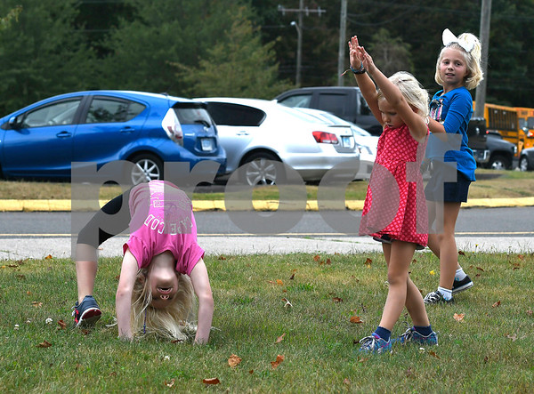 9/19/2017 Mike Orazzi | Staff Ella Smith (left) and her sister Lucy practice their tumbling skills with Brooklynne Whitlock after school outside the Edgewood School in Bristol Tuesday afternoon.