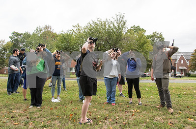 09/19/17 Wesley Bunnell | Staff  CCSU Professor Sylvia Halkin lead her Natural History Class through a walk in Stanley Quarter Park on Tuesday afternoon for the lab portion of the course. Ondine Fraher, middle, uses her binoculars along with fellow classmates to observe various trees in the park.
