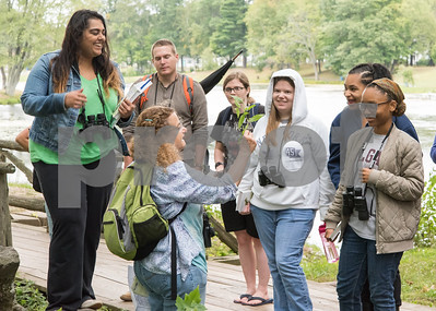 09/19/17 Wesley Bunnell | Staff  CCSU Professor Sylvia Halkin lead her Natural History Class through a walk in Stanley Quarter Park on Tuesday afternoon for the lab portion of the course. Professor Halkin holds a plant to help students including Taylor Morrison, R, to identity the different characteristics.