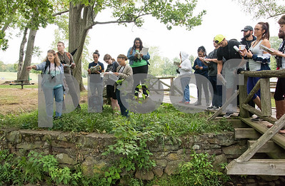 09/19/17 Wesley Bunnell | Staff  CCSU Professor Sylvia Halkin lead her Natural History Class through a walk in Stanley Quarter Park on Tuesday afternoon for the lab portion of the course. Professor Halkin, L, points to different plants along a stream in the park to help students identify the various characteristics.