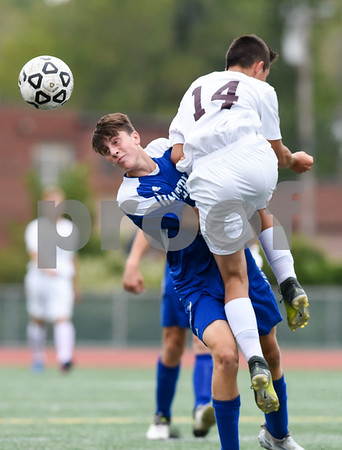 09/19/17 Wesley Bunnell | Staff Bristol Eastern boys soccer defeated New Britain 7-0 on Tuesday afternoon at Veteran's Stadium in New Britain. Bristol Easterns Jared Greger #16 and New Britain's Minel Mehmedovic (14).