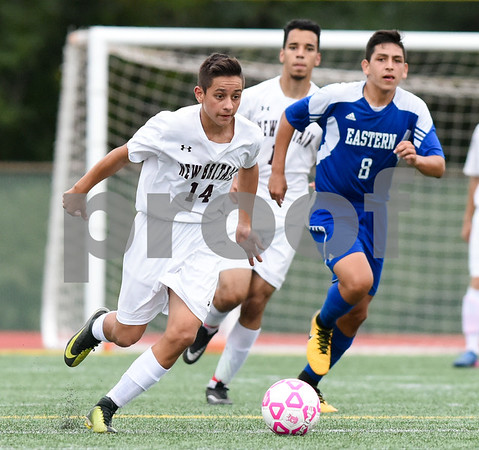 09/19/17 Wesley Bunnell | Staff Bristol Eastern boys soccer defeated New Britain 7-0 on Tuesday afternoon at Veteran's Stadium in New Britain. New Britain's Minel Mehmedovic (14) and Bristol Easterns Dante Constantiello #8.
