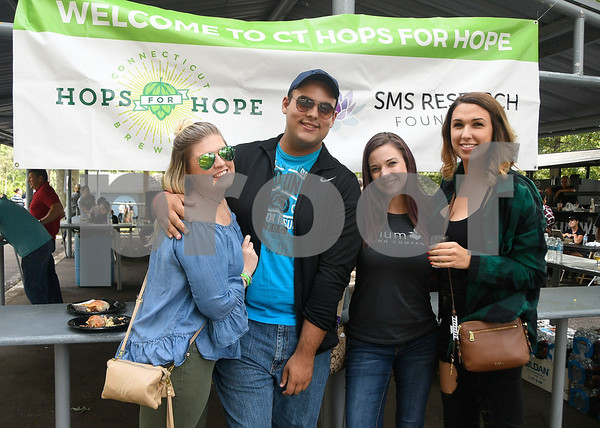 9/2/2017 Mike Orazzi | Staff Tiffany Wood, Luke Lamare, Amie Ouellette and Brianna Lynes while at the 2nd CT Hops for Hope beer festival held at Falcon Field in New Britain Saturday.