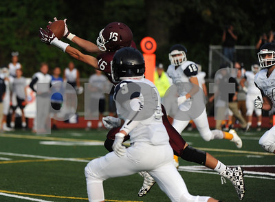 9/22/2017 Mike Orazzi | Staff Bristol Central's Nathan Rosa (16) hauls in a pass during Friday night's football game with Wethersfield in Bristol.