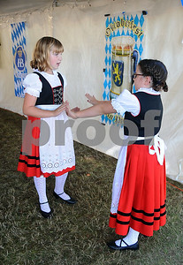 9/23/2017 Mike Orazzi | Staff Alpenland Dancers Children's Group Grace Libby Ella Barry during the St. Peter Church Oktoberfest in New Britain Saturday.