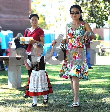 9/23/2017 Mike Orazzi | Staff JieJie Zong (left) and Victoria Freitag and her mom Yanyan during the St. Peter Church Oktoberfest in New Britain Saturday.