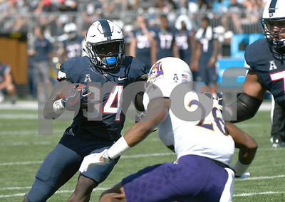 9/24/2017 Mike Orazzi | Staff UConn's Kevin Mensah (34) during Sunday's football game with East Carolina State University at Rentschler Field in East Hartford.