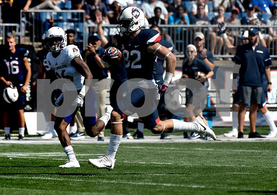 9/24/2017 Mike Orazzi | Staff UConn's Mason Donaldson (82) on his way to a TD during Sunday's football game with East Carolina State University at Rentschler Field in East Hartford.