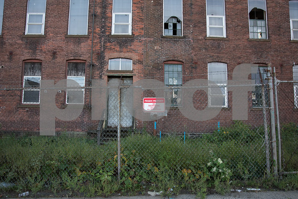 09/26/17 Wesley Bunnell | Staff A no trespassing sign on a Stanley Black & Decker building on Myrtle St near the intersection with Curtis St. which is marked for demolition.