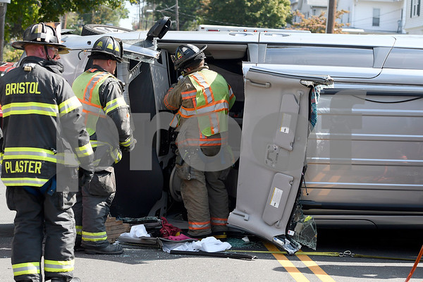 9/26/2017 Mike Orazzi | Staff Bristol firefighters while extricating the driver of a van involved in a rollover crash on Woodland Street in Bristol Tuesday morning.