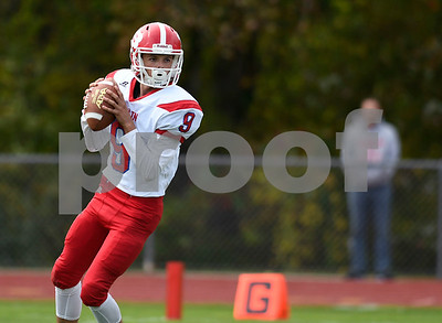 9/30/2017 Mike Orazzi | Staff Berlin's Kevin Dunn (9) during Saturday's football game in Hebron.
