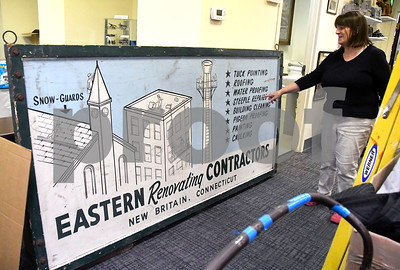 9/30/2017 Mike Orazzi | Staff Karen Hudkins talks about items inside the new location of the New Britain Industrial Museum on West Main Street Saturday.
