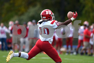 9/30/2017 Mike Orazzi | Staff Berlin's Larry St. Pierre Jr. (10) hauls in TD pass with one hand during Saturday's football game in Hebron.