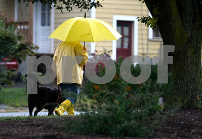 9/6/2017 Mike Orazzi | Staff A rainy day in the Federal Hill area of Bristol Wednesday as a woman walks a dog.