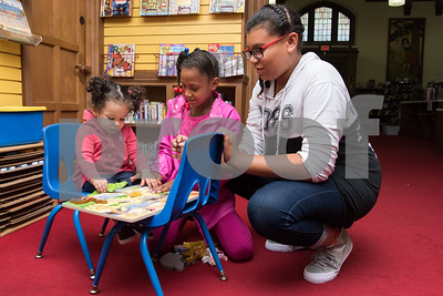 09/06/17 Wesley Bunnell | Staff  One year old Daneisha Cruz plays inside of the children's room at the New Britain Public Library on a rainy Wednesday afternoon along with sisters Nadyah Pena and Anaiyze Pena.