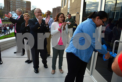 11/11/2014 Mike Orazzi | Staff Bristol Boys & Girls Club Dayana Tovar cuts the ribbon at the opening of the facility at 255 West St. Tuesday.