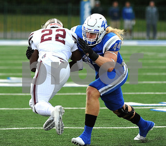 9/9/2017 Mike Orazzi | Staff CCSU's Seth Manzanares (44) and Fordham's Chase Edmonds (22) during Saturday's game in New Britain.