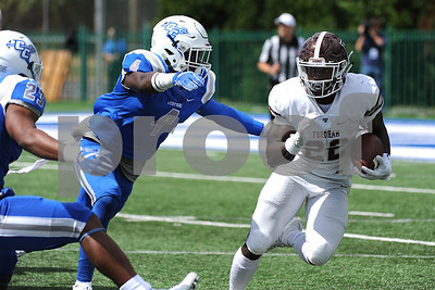 9/9/2017 Mike Orazzi | Staff CCSU's Randall LaGuerre (4) and Fordham's Chase Edmonds (22) during Saturday's game in New Britain.
