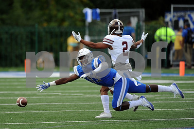 9/9/2017 Mike Orazzi | Staff CCSU's Najae Brown (13) and Fordham's Corey Caddle (2) during Saturday's game in New Britain.