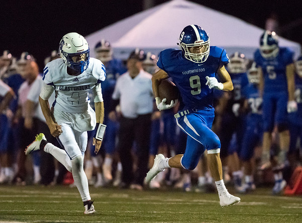 09/07/18 Wesley Bunnell | Staff Southington football defeated Glastonbury Friday night at Southington High School. William Downes (9) with a big run after the catch for a touch down.