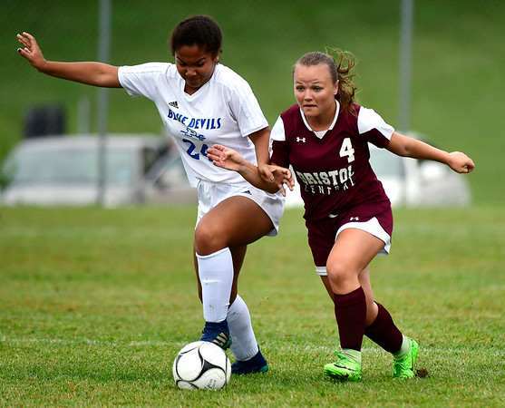 9/7/2018 Mike Orazzi | Staff Plainville's Jordan Thompkins (24) and Bristol Central's Faith Roy (4) during Friday's soccer at BC.