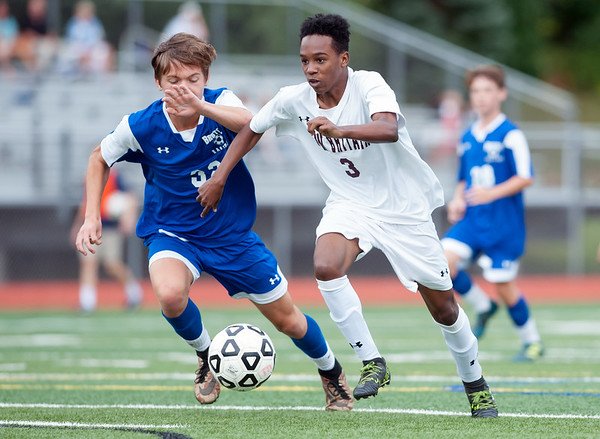 09/17/18 Wesley Bunnell | Staff Bristol Eastern soccer defeated New Britain 2-0 on Monday afternoon at Bristol Eastern High School. Bristol Eastern's Gabe Soucy (32) and New Britain's Andwel Samlon (3).