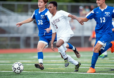 09/17/18  Wesley Bunnell | Staff  Bristol Eastern soccer defeated New Britain 2-0 on Monday afternoon at Bristol Eastern High School. Bristol Eastern's Gabe Soucy (32), New Britain's Andwel Samlon (3) and Bristol Eastern's Drew Dauphinee (13).