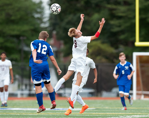 09/17/18 Wesley Bunnell | Staff Bristol Eastern soccer defeated New Britain 2-0 on Monday afternoon at Bristol Eastern High School. Bristol Eastern's Konrad Olekszyk (12) and New Britain's Konrad Piechota (9).