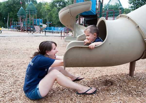 09/17/18 Wesley Bunnell | Staff Kara Gardner is all smiles as her son John, age 3, exits a slide at Rockwell Park on Monday afternoon.