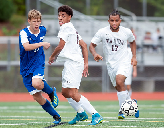 09/17/18 Wesley Bunnell | Staff Bristol Eastern soccer defeated New Britain 2-0 on Monday afternoon at Bristol Eastern High School. Bristol Eastern's Jake Woznicki (10) and New Britain's Nolber Gonzalez (17).