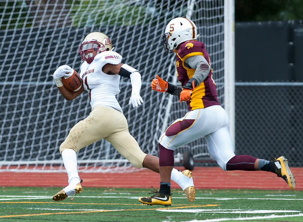 09/21/18 Wesley Bunnell | Staff New Britain football at South Windsor High School on Friday afternoon. DB Kaiyon Gunn (1) with a pick off for a touchdown return.