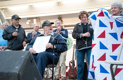 09/21/18  Wesley Bunnell | Staff  2018 Bristol Hometown Hero Ed Pelkey looks on as members of the Korean War Veterans Rachael Dione and Alice Testa hold up a quilt presented to Ed.