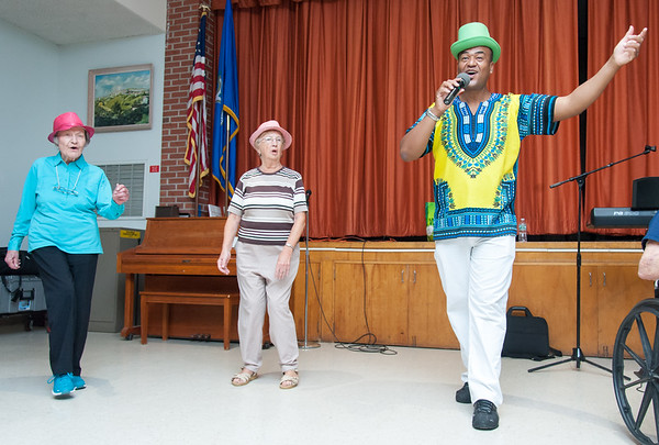 09/21/18 Wesley Bunnell | Staff Entertainer Jose Paulo of Newington, R, leads Mary Ann Goodell, L, and Emily Fearnley through a rendition of New York New York on Friday September 21 as part of the Berlin Senior Center's annual picnic.