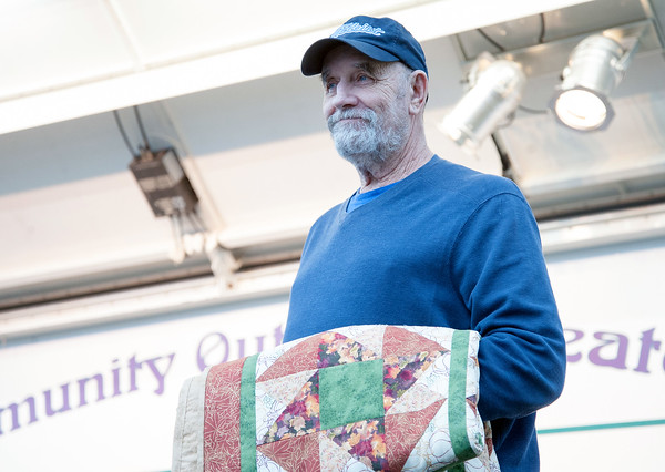 09/21/18 Wesley Bunnell | Staff 2017 Bristol Hometown Bob Montgomery was presented with a hand made quilt after the award presentation for 2018 recipient Ed Pelkey on Friday night at the Mum Festival on Memorial Boulevard.