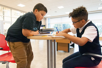 09/24/18  Wesley Bunnell | Staff  Nick Burgos, age 10 R, works on his math homework at the Bristol Boys and Girls Club on Monday afternoon as friend Eliel Mena, age 11, looks on.