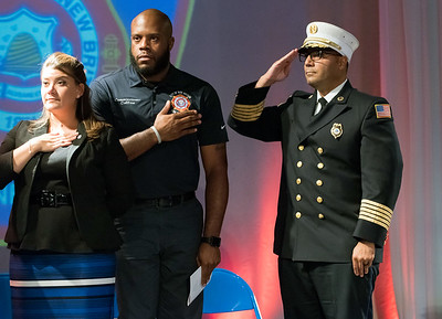 09/20/18  Wesley Bunnell | Staff  The New Britain Fire Department held their 2018 Awards Ceremony on Thursday September 20 at Trinity on Main. Mayor Erin Stewart,  middle, Chairman of the Fire Board Tremell Collins and Fire Chief Raul Ortiz during the National Anthem.