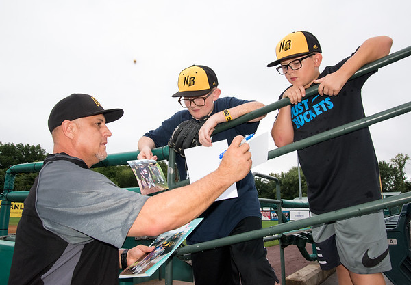 09/12/18 Wesley Bunnell | Staff Bees hitting coach Miguel Gomez autographs photos for brothers Marcus Correa, L age 13, and Mason Correa, age 11, which were taken from an earlier Bees summer camp. The brothers, along with their mother Kate Gadd have attended every Bees home game this season in addition to baseball camps and the All Star Game in Long Island. The game was the final Bees home game of the 2018 season.