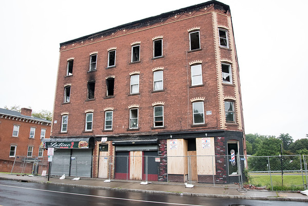 09/12/18 Wesley Bunnell | Staff 408 - 410 Arch St in New Britain which needed to be secured with additional plywood over windows and doors after trespassers have been entering the burned out building.