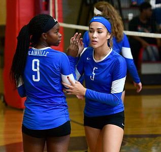 9/12/2018 Mike Orazzi | Staff Plainville's Shai­yonna Durham (9) and Samantha Lozefski (5) at Bristol Central Wednesday night.