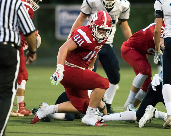 09/13/18 Wesley Bunnell | Staff Berlin football vs East Catholic at Sage Park on Thursday night. Zachary Hrubiec (44) looks back after a sack of the East Catholic quarterback.